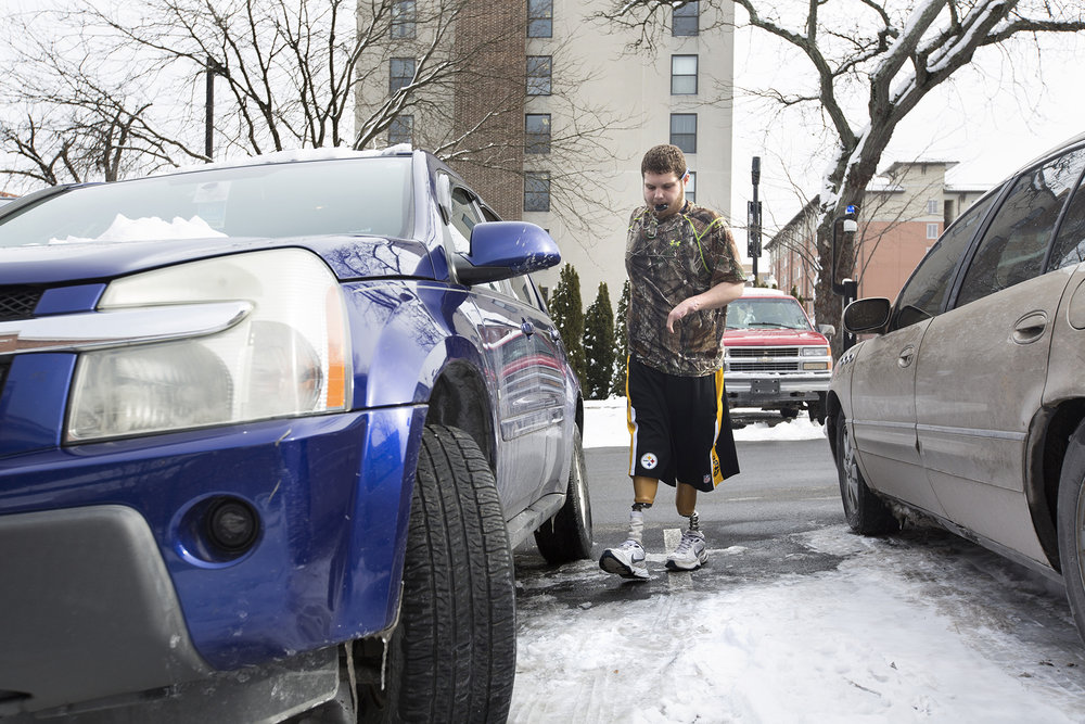 Sean Brame parks his car on West College Avenue going to lab to study after a morning work out.