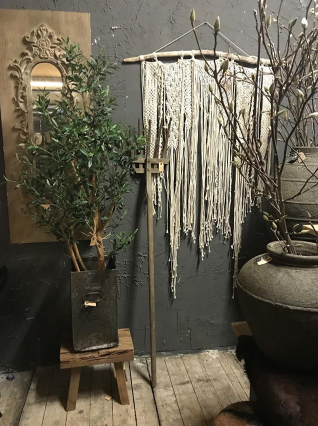 One of our handmade macrame wallhangings (this one is sold), styled in the beautiful shop of Bloemenservice Nederland
