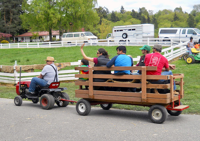 At shows, garden tractors often serve as people movers.