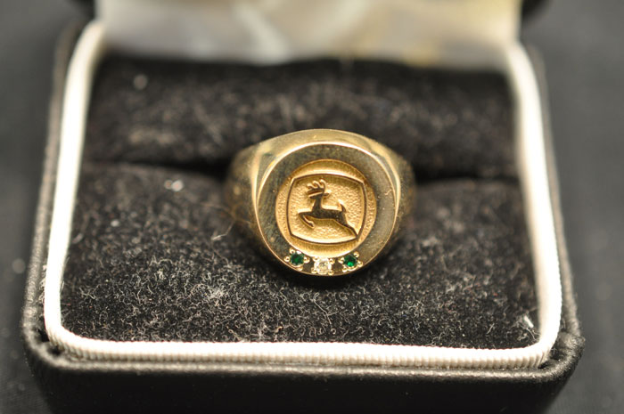 This John Deere ring is one of the many collectibles selling at this online-only auction.