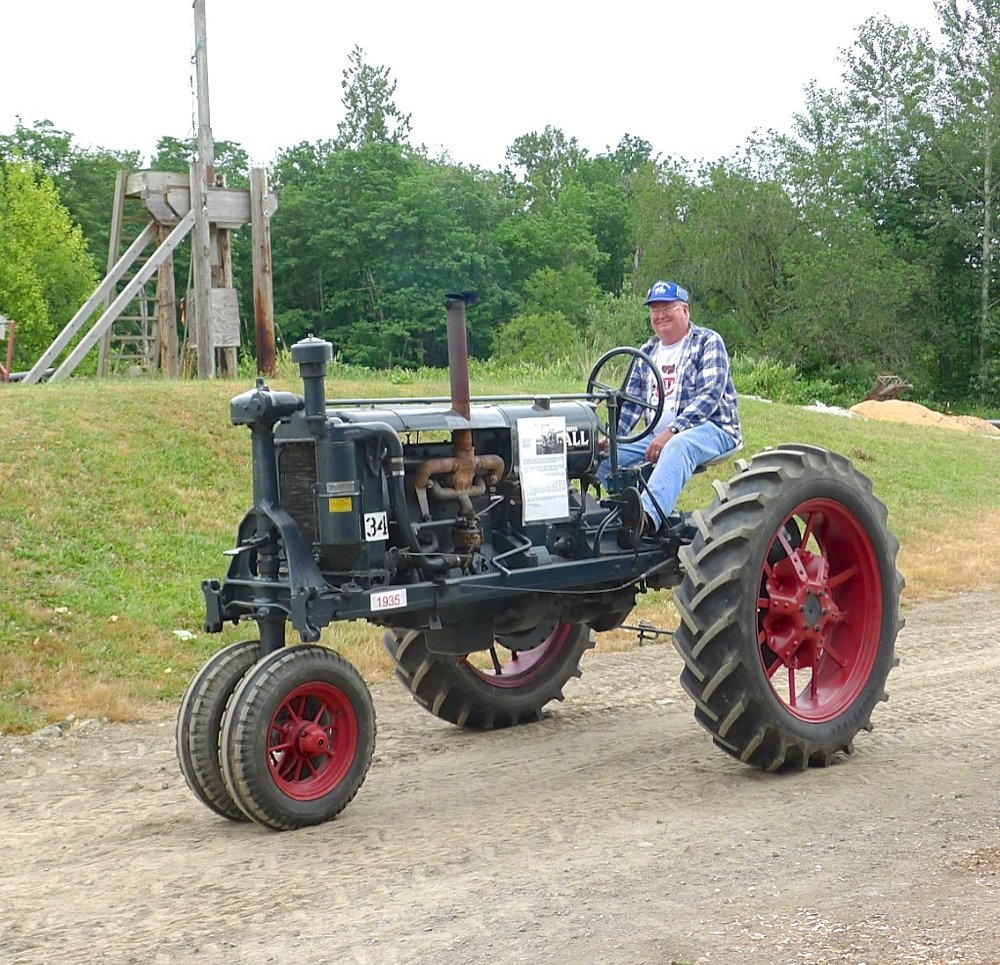 Phil Scott posed on his family heirloom, a 1935 McCormick-Deering Farmall, during a parade at a tractor show in Carnation, Washington. Photo Candace Brown
