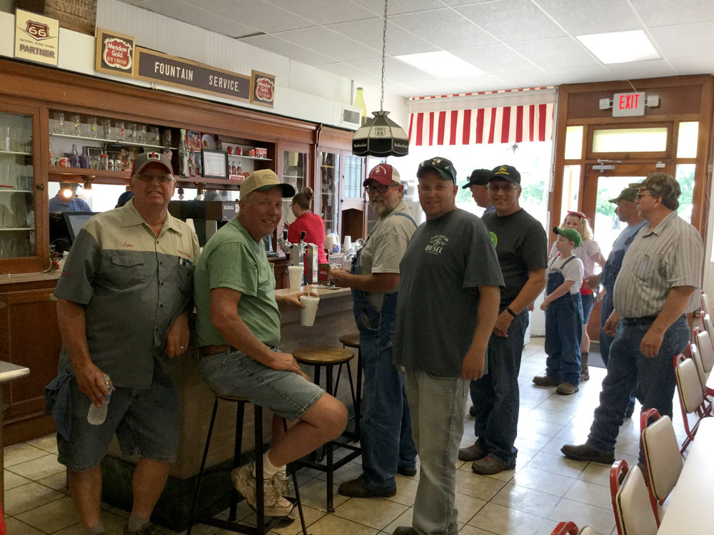Tractor drivers took a break in Girard, Illinois, and enjoyed a bit of Route 66 hospitality at Doc's Soda Fountain.