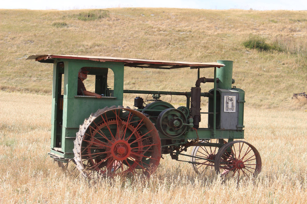 This shot of an old Case being driven through the grass is reminiscent of the old days when Prairie tractors roamed the fields.  Photo Luke Steinberger