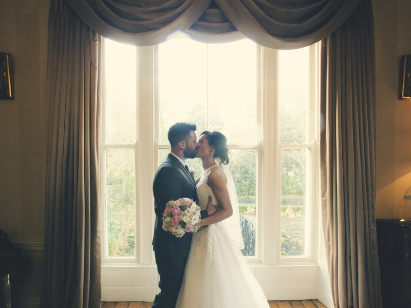 Tulfarris Hotel & Golf Resort bride and groom embracing wedding Wicklow.jpg