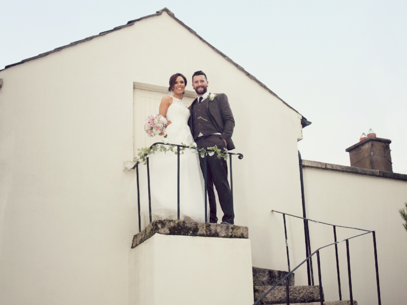 Tulfarris Hotel & Golf Resort bride and groom posing outside wedding.jpg