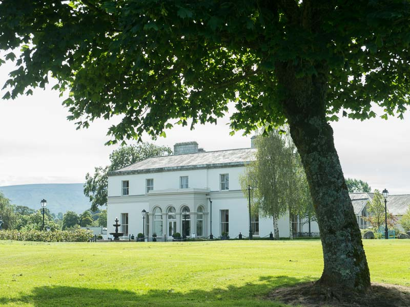 Exterior of Manor House and the surrounding gardens at Tulfarris Hotel In Wicklow