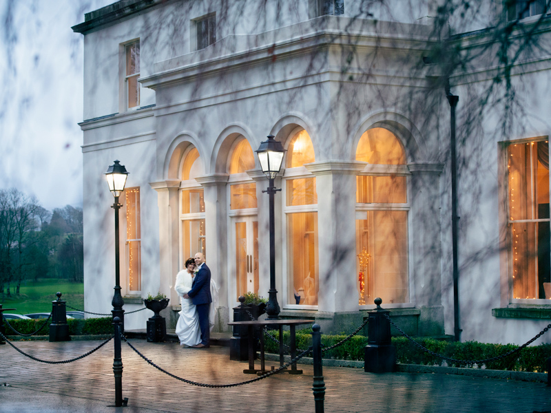 Wedding couple taken their picture outside Tulfarris Hotel in Wicklow