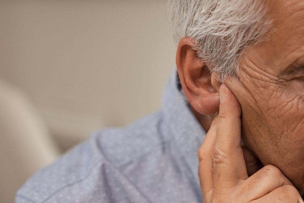 senior-man-with-hearing-problems-68VZQH2.jpg