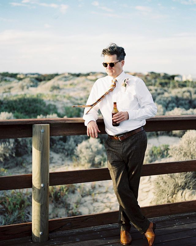 Andrew waiting patiently while the bride and groom have their portraits taken. Tones that only film can deliver.  Shot for @perth_weddings