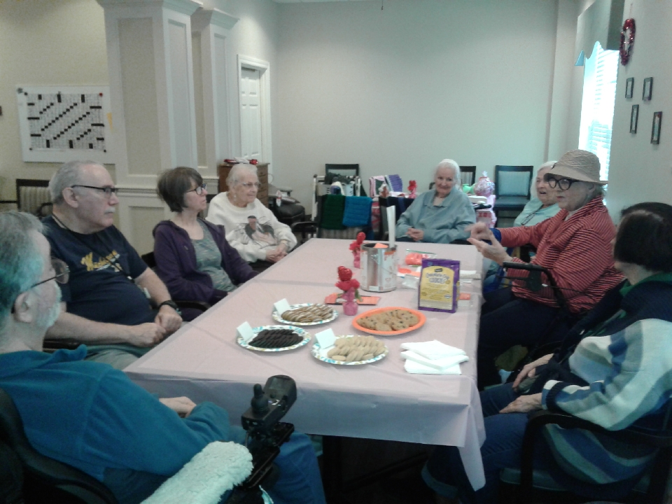 A group of residents at The Bickford attend a presentation about Random Acts Matter by Pat Reding.