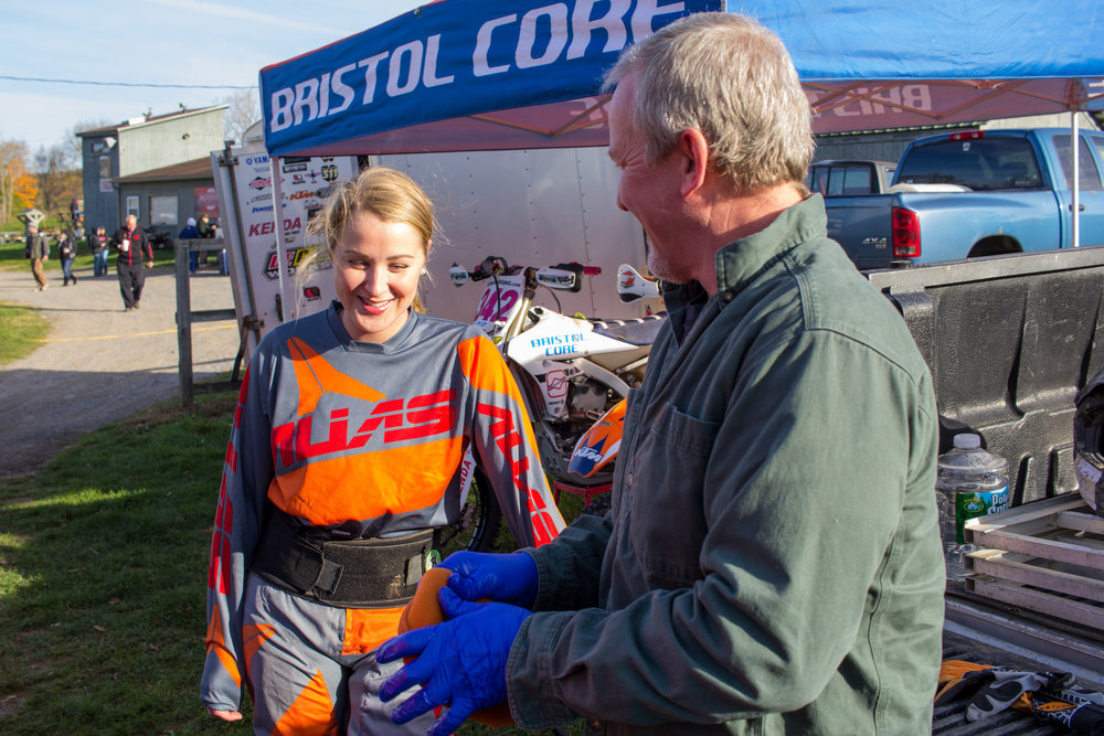 Mallory jokes with her father Mike before a big race. Mike has been racing motorcycles since his teen years and encouraged Mallory to take up the sport as soon as she could get on a bike. 2016