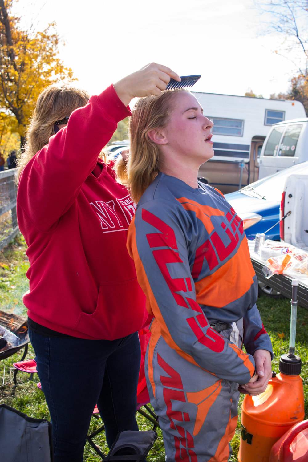 April Angelo, Mike Eberhardt's girlfriend, combs Mallory's hair after she takes her helmet off. 2016.