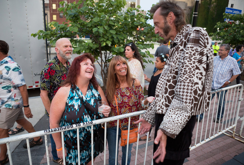 Jean-Marc Noirot-Cosson talks with onlookers before he goes on to perform with Plasticiens Volants in Rochester, N.Y. The show would be only the second time Plasticiens Volants would perform in the United States. 2017.