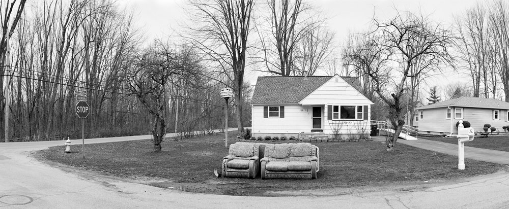 I strove to give a new view to the American suburb, and through the use of self-developed black and white film and a very hands-on camera, acknowledge and appreciate the people that live there.