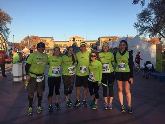 Athlete Mark McCowan with his guides during Philadelphia Marathon weekend.