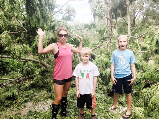 My nephews and me, in my backyard post-Hurricane next to a downed tree. Clearly, we are not amused.