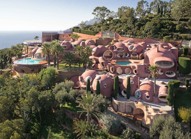 Pierre Cardin's iconic Bubble Palance was designed by Hungarian architect Antti Lovag.  The unique living spaces are composed of interconnecting terracotta orbs which flow into beautiful gardens overlooking the Bay of Cannes.