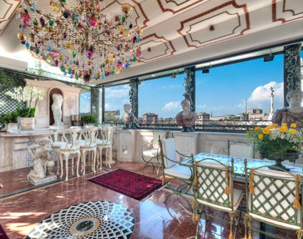 The magnificent three-story, 3,767-square-foot penthouse is situated within a Renaissance palace overlooking the Piazza Venezia, the Basilica of Santa Maria in Ara Coeli, and the National Monument of Victor Emmanuel II.