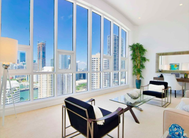 This designer duplex on the exclusive island of Brickell Key overlooks downtown Miami, Biscayne Bay, and the Atlantic Ocean.
