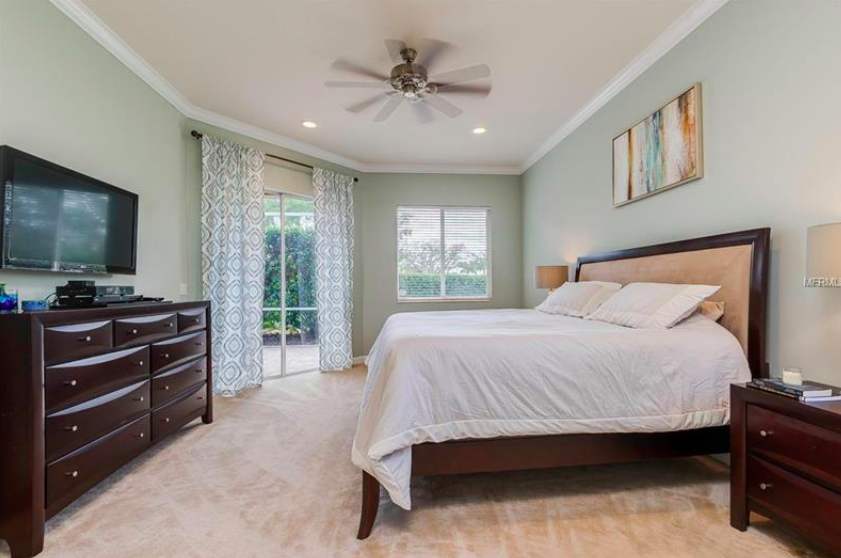 Soaring ceilings of 10-12' feet in height throughout the home make every space feel very open, and the multitude of windows keep the home light & bright!  The master retreat features a walk-out to the lanai, as well as a large master bath and two walk-in closets.