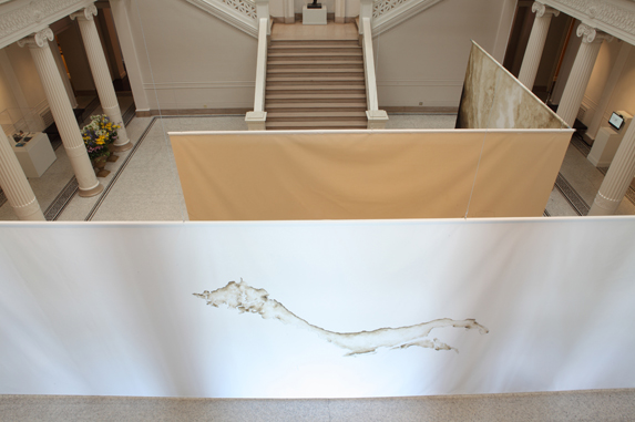Installation view:  Found Island (Creole Bay / Pine Island) , [recto], 2012, graphite and sediment collected from the Mississippi River and acrylic gel medium on primed canvas, 12 x 36 feet.