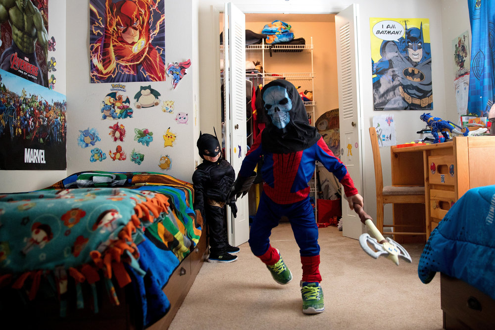Jahan, left, and Arshaan play at home in their superhero costumes in January.