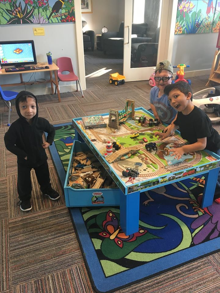 Arshaan, Jahan and Levi in the playroom at the RMH, Delaware
