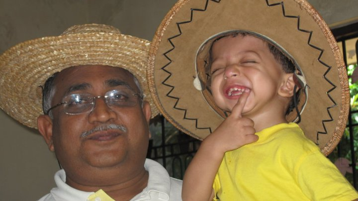 Neena's father with her son.