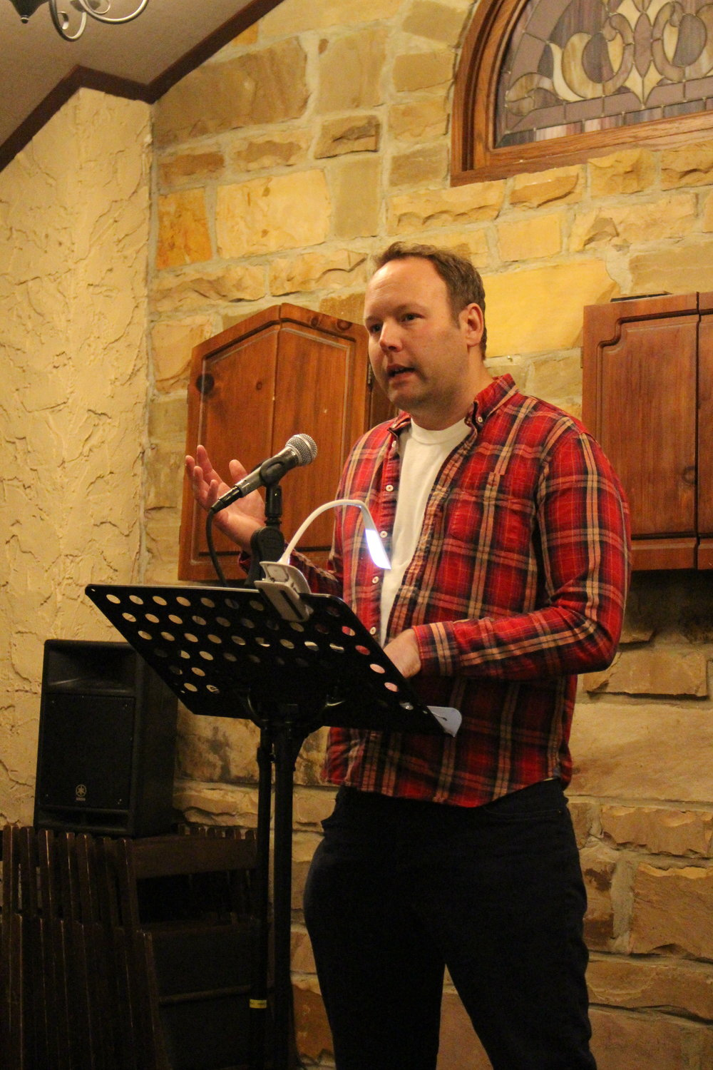 Ryan Kenealy reads at the Sunday Salon pop-up at the Celtic Knot. (Photo by Lynn Haller.)