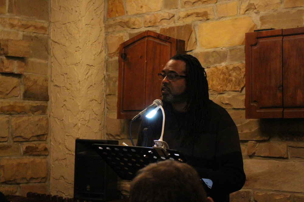 Quraysh Ali Lansana reads at the Sunday Salon pop-up at the Celtic Knot. (Photo by Lynn Haller.)