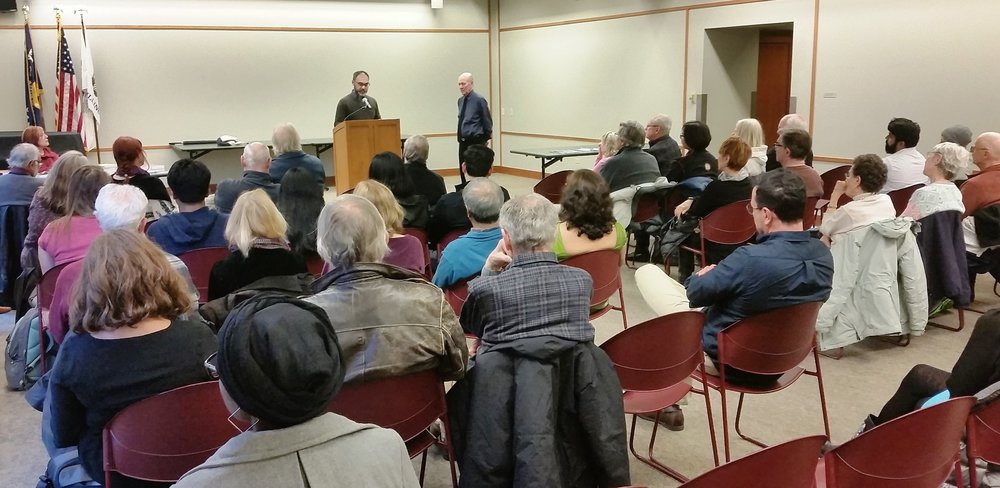 Faisal Mohyuddin reads from the Chicago Quarterly Review at Evanston Public Library. (Photo by Russell Johnson.)
