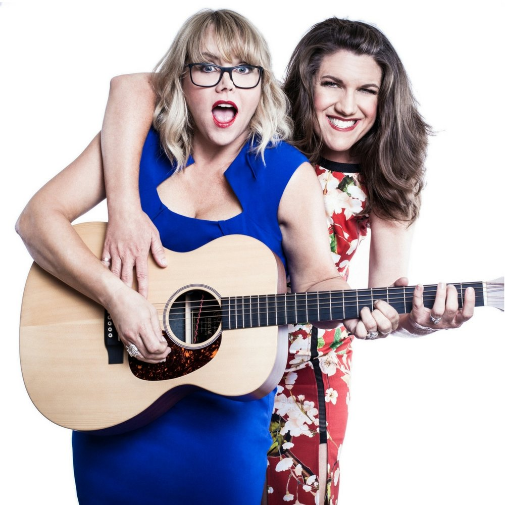 Shannon Noel & Stacie Burrows.     2 Moms. 1 Guitar. Cursing in Perfect Harmony.