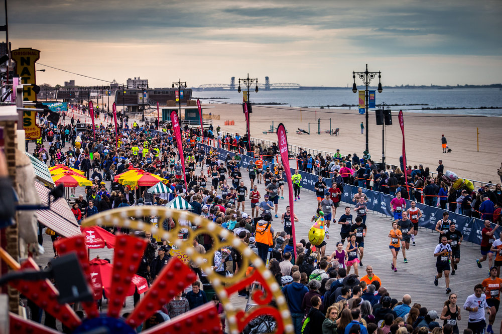 On race day, more than 27,000 half-marathoners and 1,000 youth runners will cross the  finish line on the Coney Island Boardwalk.