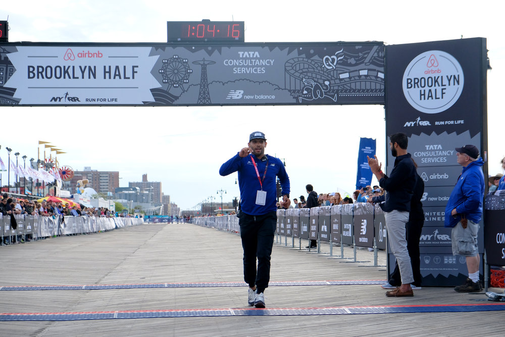 Crispin makes a last-minute check over the Airbnb Brooklyn Half finish area before the first runners arrive.