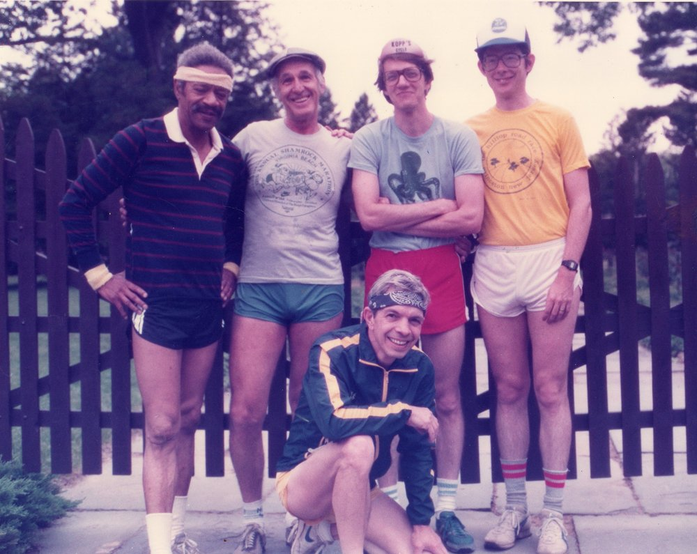 My dad (kneeling) with his running group