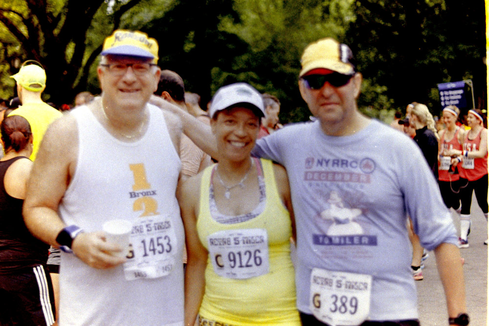 NYRR Members showing off their gear from the Bronx Half (ca. early 2000s) and a holiday 10-miler from the 1980s
