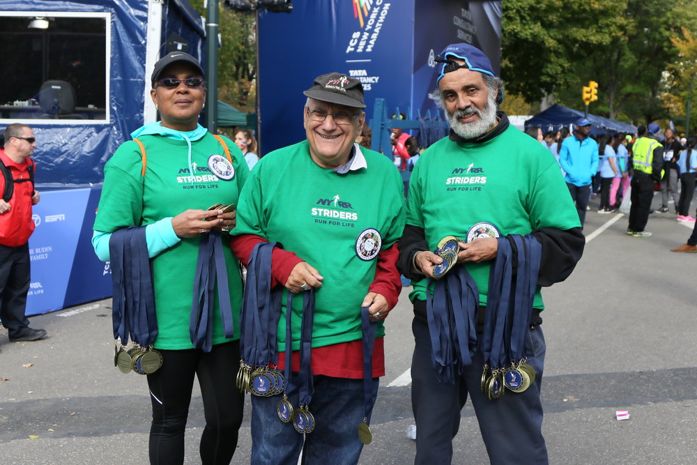 On November 3, 2016, NYRR Striders handed out finisher medals at the TCS Run with Champions, a marathon-week event for youth athletes.