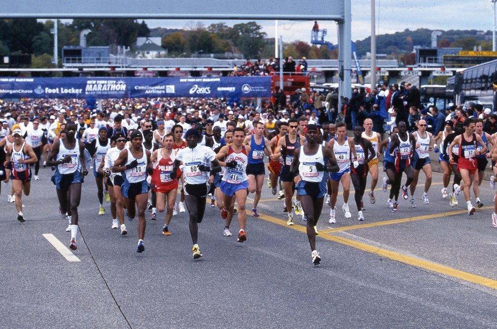 Keflezighi (left side, bib #10) makes his first trip up the Verrazano-Narrows Bridge.