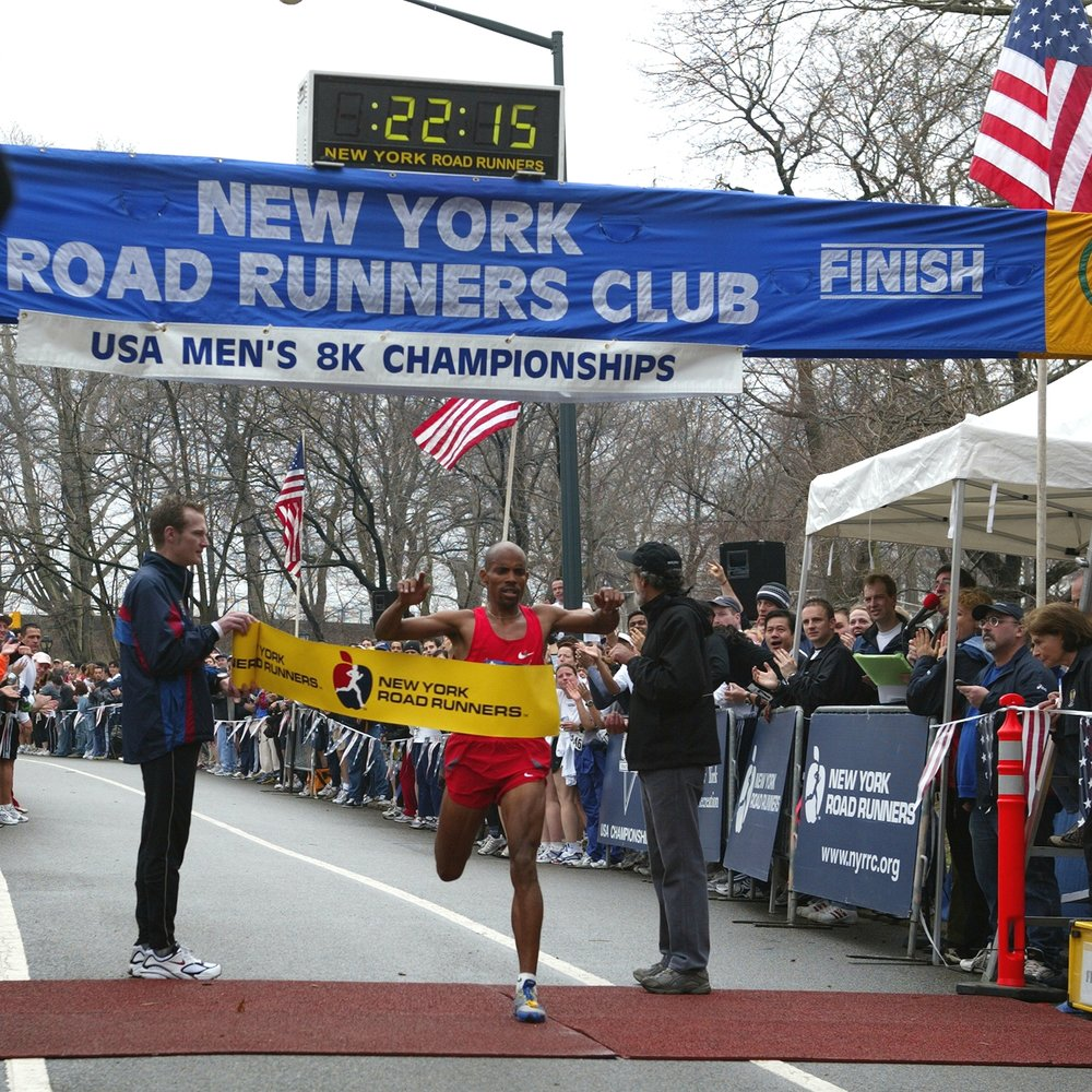 Breaking the tape at the 2004 USA Men's 8K Championships, held in Central Park that March.