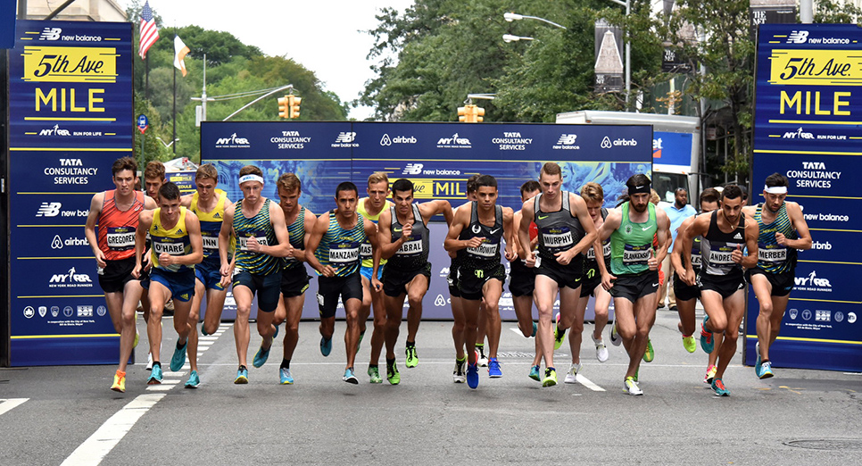 Kyle Merber (far right) kicks it into high gear at the start of the 2016 New Balance 5th Avenue Mile.