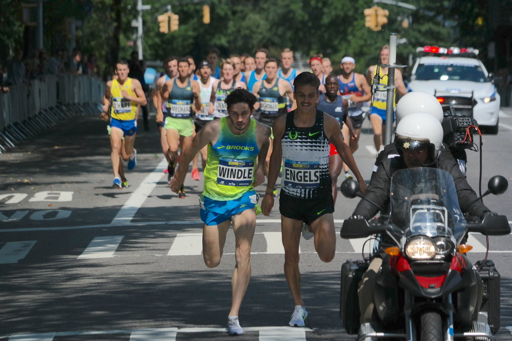 Windle and Engels try to outlean one another for the $1,000 halfway prize as they cross East 70th Street; Engels finished behind Windle here, but finished the race under 4:00 to earn the prime.