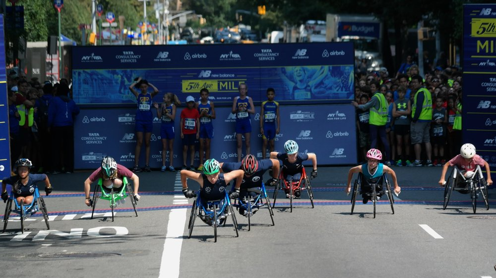 Young athletes in the spotlight at the start of the second-annual Youth Wheelchair Invitational Mile at the New Balance 5th Avenue Mile