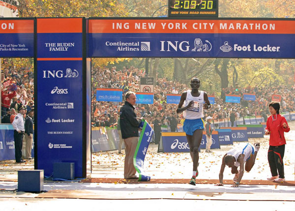 Tergat would win by three-tenths of a second as Ramaala fell to the ground.