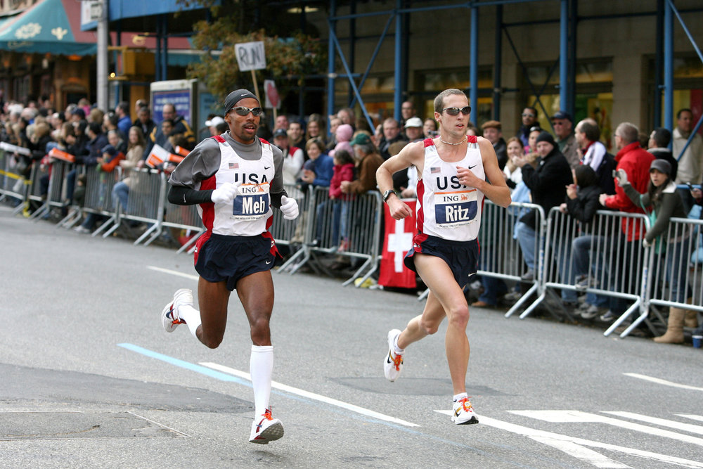 Keflezighi and Dathan Ritzenhein in a chase pack on First Avenue in Manhattan.