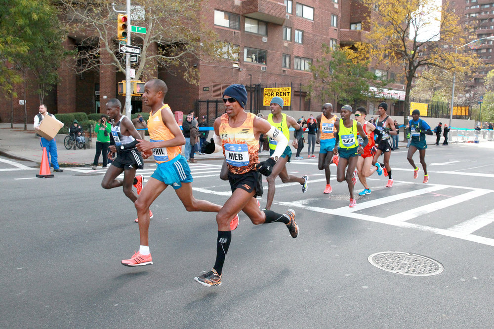 Keflezighi in the lead crossing 110th Street and First Avenue