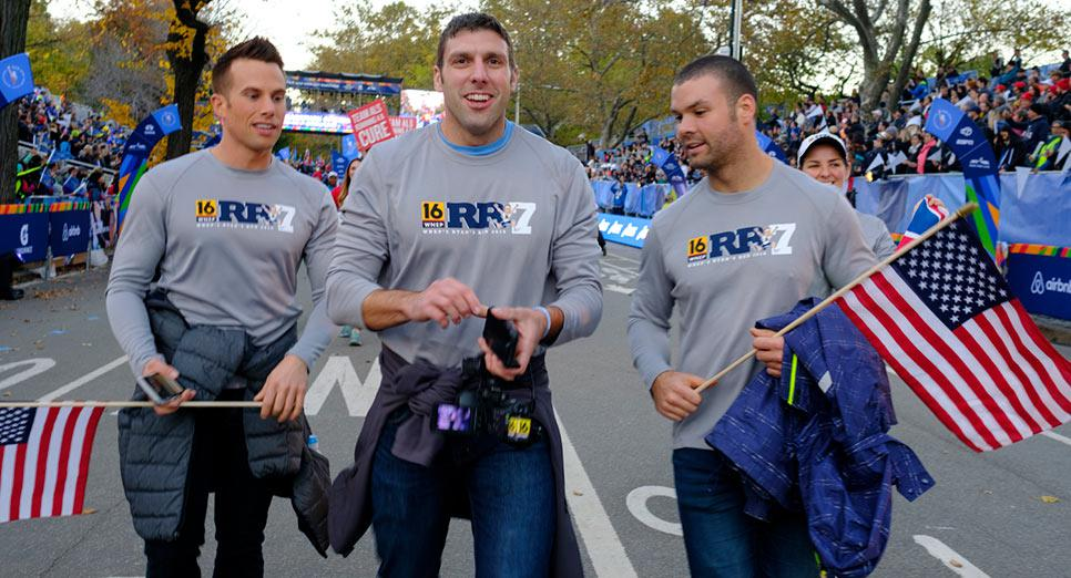 Ryan Leckey (left) and his colleagues take part in the 2016 TCS New York City Marathon Opening Ceremony Presented by United Airlines.