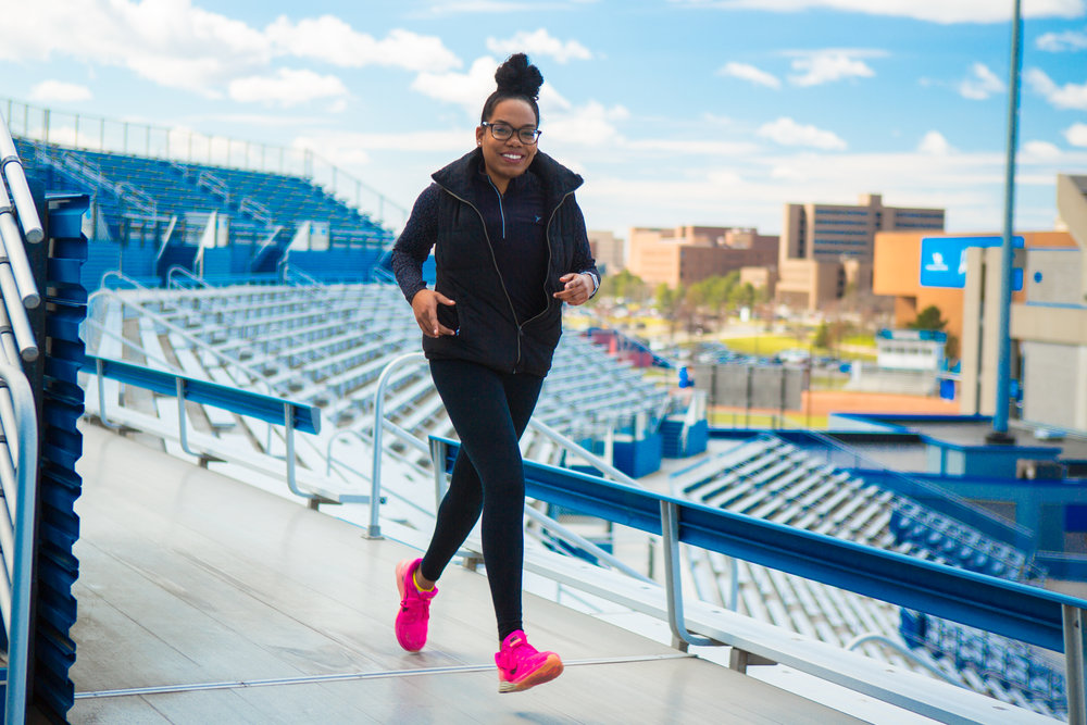 NYRR Run for the Future alum Patricia Lorquet goes for a jog on campus at University of Buffalo, where she's a senior majoring in biological sciences.