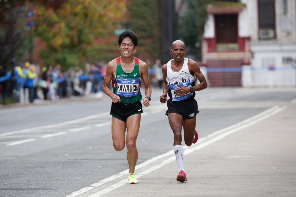 Keflezighi and Kawauchi running together around Marcus Garvey Park in Harlem