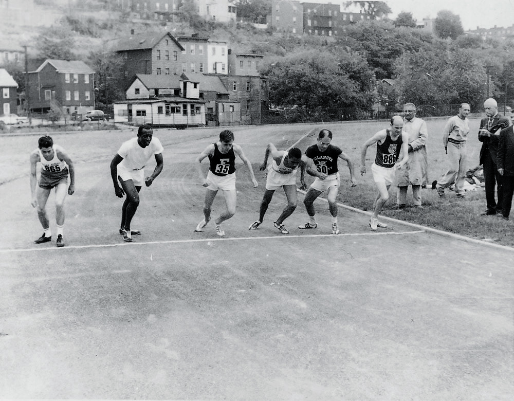 The start of the 5000m Regional Championship, May 31, 1964, Yonkers, NY. Soon-to-be Olympian Pete McArdle (far right) won in 14:17.2. Norbert Sander is third from left; he would win the 1974 New York City Marathon, revitalize The Armory in the 1990s, and serve on NYRR's board of directors until his death in 2017.