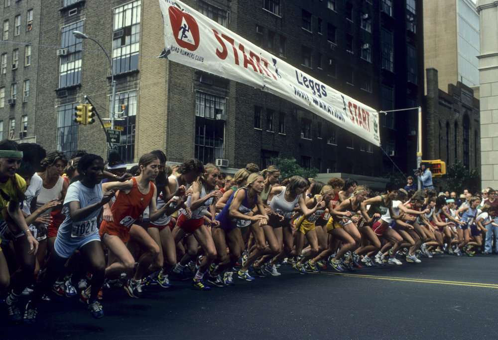 Runners at the starting line of the Mini in its early years. Nine-time champion Grete Waitz of Norway (red shorts, white singlet) is eighth from the left.